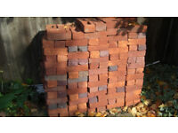 Approx 200 new unused mock tudor bricks left over from building project.Mainly orangey red some blue