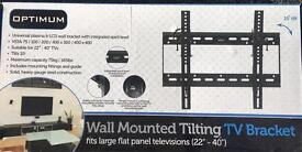 Wall mounted tilting TV stand / bracket