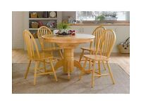 Round solid wood dining table and 4 matching chairs.