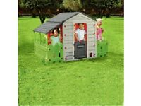 Garden playhouse with fencing like new can deliver for a small charge