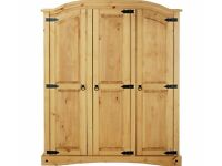 Ex display Mexican pine 3 door wardrobe. Less 1/2 price as SOLD WHOLE, delivery available.