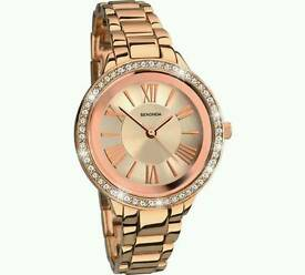 Women's gold and pink watch