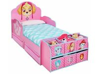 New Toddler bed. Paws Patrol, pink. Less 1/2 shop price. Boxed. Delivery available. Drawers under.