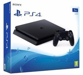 1TB Playstation 4 Slim with game (FIFA 17) BNIB..£200 ONO.