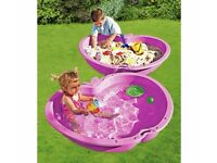pink shell sandpit/swimming pool