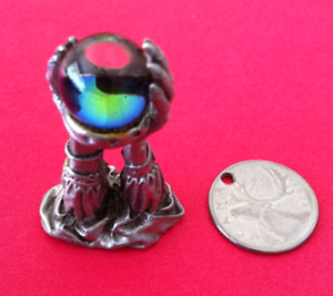 Pewter arms with crystal ball