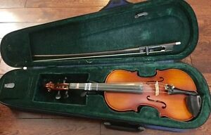 Half size violin with case and bow, great condition,