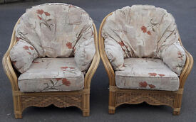 Two matching good quality cane conservatory chairs