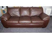 Large 3 seater leather sofa dark brown colour.