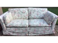Two Marks and Spencer sofas for sale: plain green two-seater and floral pattern three-seater.