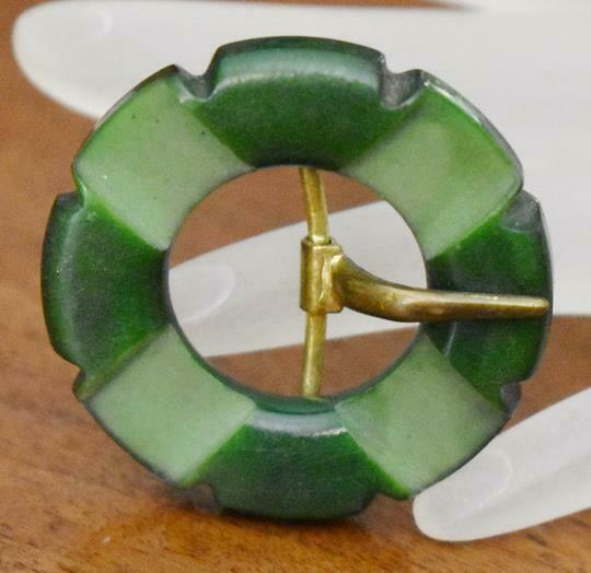 LOVELY VINTAGE SMALL SHADES OF GREEN ROUND CARVED BAKELITE BELT BUCKLE