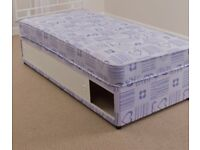 Single divan bed and mattress with sliding door storage.