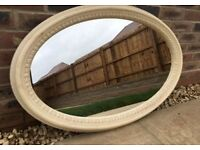 Cream marble oval shaped mirror