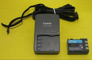 Canon CB-2LW Camera Battery Charger, a Canon NB 2LH Battery +