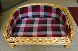 Wicker dog bed with foam cushions