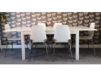 White Ikea extendable table and six chairs