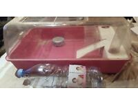 1 pink hamster cage