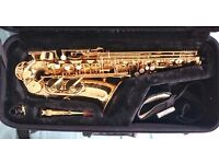 Jupiter Alto Saxophone with a case and music books