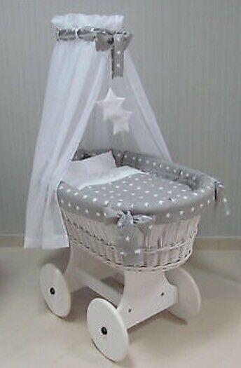 Like new. Grey and white wicker crib.