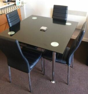 Glass dining table with 4 chairs Melbourne CBD Melbourne City Preview