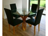 Circular Glass and Wood Dining Table and 4 Black Leather Chairs