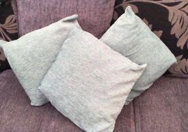 3 teal cushions