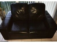 Black leather sofas 3 & 2