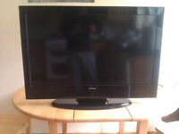 "SilverCrest 32"" Full HD 1080p LCD TV in good condition with remote in its box"