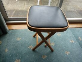 VINTAGE FOLDING HAND MADE WOODEN STOOL WITH PADDED SEAT.