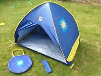 Childrens pop up uv beach tent.