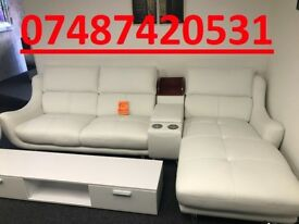 WHITE LEATHER SOFA & SWIVEL CHAIR
