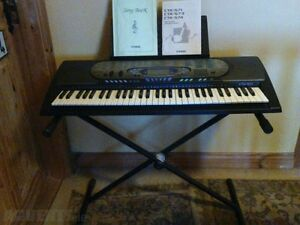 Keyboard with stand and adaptor. located in Waterloo ONT!