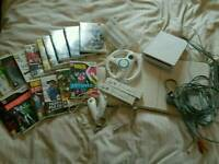 Nintendo Wii with games and accessories.