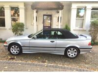 Convertible BMW 2.3i automatic in excellent condition inside, outside & engine-wise.