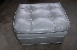 Grey faux grey leather ottoman on castors, good condition