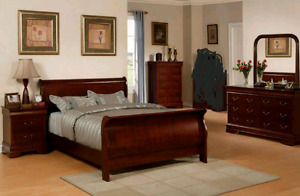 Sleigh bed set with dressers and night table mirror.