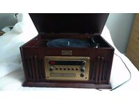 A MODERN WOOD CASE VINTAGE COLLECTION GRAMOPHONE RECORD PLAYER TAPE ,RADIO, CD PLAYER