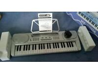 Child's electronic keyboard, as new in box with full instructions and 'Progressive keyboard' book/Cd