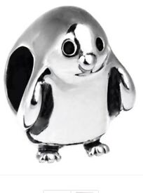 Authentic brand new Chamilia 925 Sterling silver enchanting penguin charm Brand new in original box.