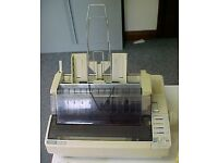 Dot matrix printer with automatic sheet feeder and labels along with spare ribbons
