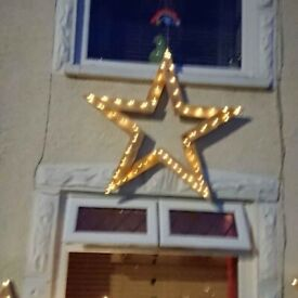 wooden stars with lights