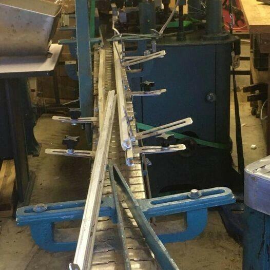 Automatic conveyer driven filler, capper, sealer bottling line.