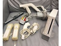 BARGAIN!! Wii Console in fully working order + 8 games + accessories + Free Wii Fit!!