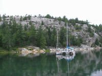Charter a sailbboat in the North Channel for $1000/ week.