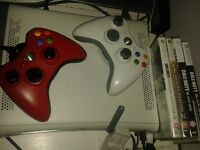Xbox 360 w/ wireless adapter, 2 controllers and 4 CoD's
