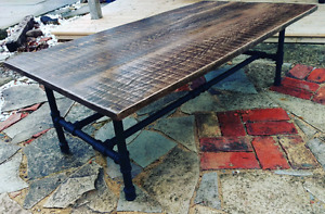 Custom reclaimed wood and industrial pipe furniture coffee table