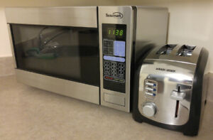Moving Sale: Beaumark Microwave and Black and Decker Toaster