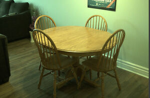 Real oak dining room table with 4 chairs