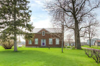 1 1/2 STOREY BRICK HOME SITUATED ON OVER AN ACRE IN THE COUNTRY