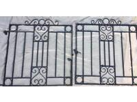 Two wrought iron driveway gates